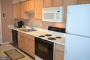 Kitchen with built-in microwave - 6505 SPRINGWATER CT #7401, FREDERICK