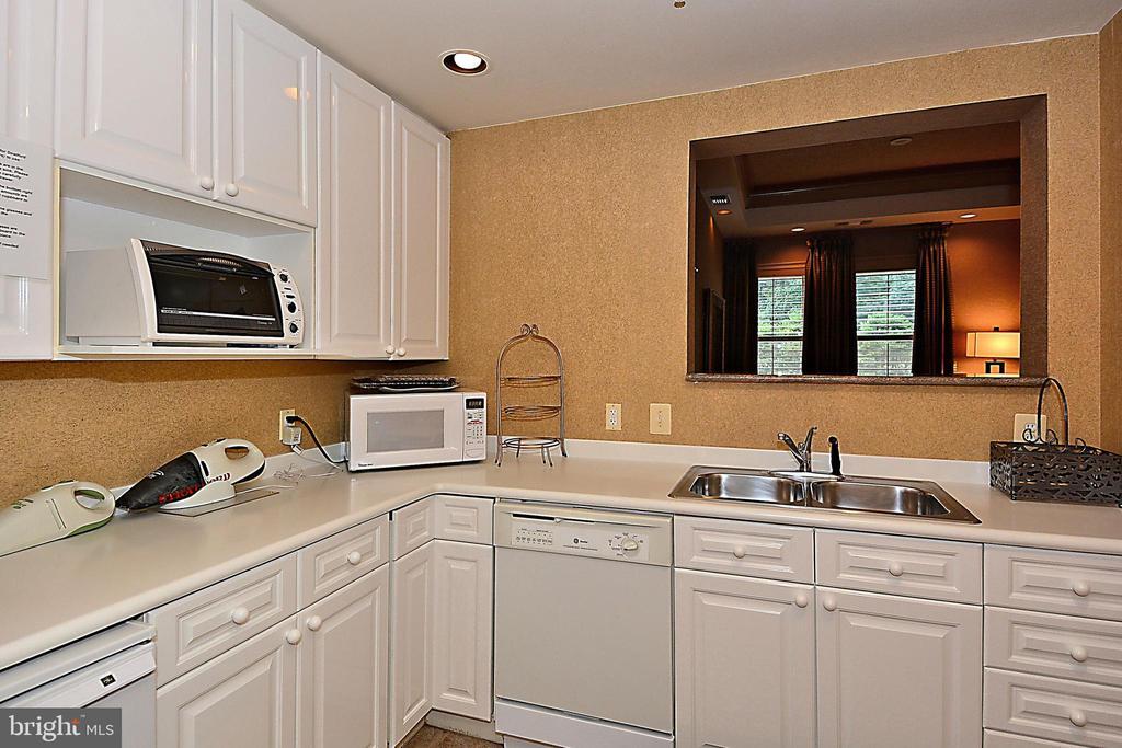 Kitchen off Party Room - 11776 STRATFORD HOUSE PL #407, RESTON