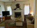 Fireplace is the focal point of the family room - 8300 MUSKET RIDGE LN, FREDERICKSBURG