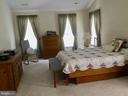 Primary bedrrom with lots of room & walk in closet - 8300 MUSKET RIDGE LN, FREDERICKSBURG