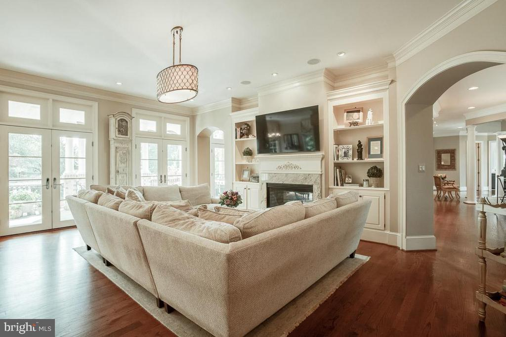 Cozy Family Room with 2 SidedGas Fireplace - 15830 SPYGLASS HILL LOOP, GAINESVILLE