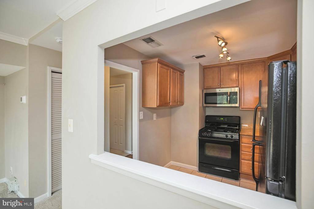View from Living/Dining Room to Kitchen - 10570 MAIN ST #517, FAIRFAX
