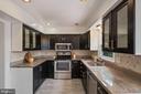 Kitchen with Granite - 1406 POWELLS TAVERN PL, HERNDON