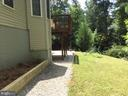Walkway from garage to the back of the house - 8300 MUSKET RIDGE LN, FREDERICKSBURG