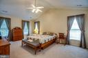 Primary bedroom with cathedral ceilings - 8300 MUSKET RIDGE LN, FREDERICKSBURG