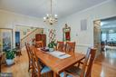 Formal dining room with view into the kitchen - 8300 MUSKET RIDGE LN, FREDERICKSBURG