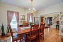 Spacious dining room with view into the foyer - 8300 MUSKET RIDGE LN, FREDERICKSBURG