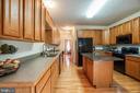 Kitchen with work island - 8300 MUSKET RIDGE LN, FREDERICKSBURG