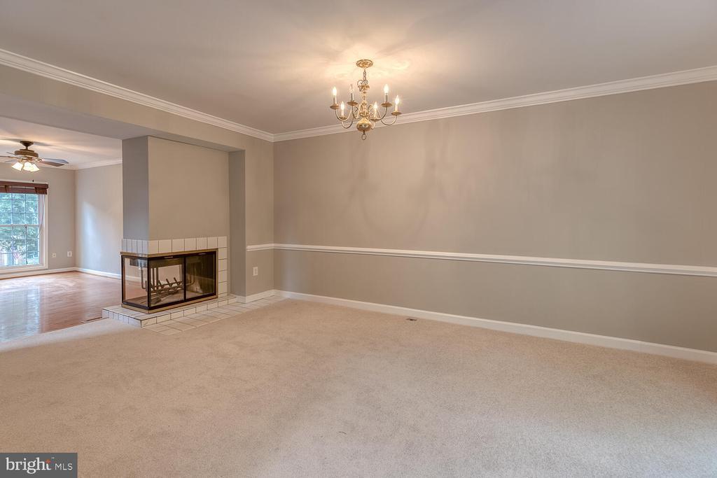 Double sided fireplace - 12659 WIMBLEY LN, WOODBRIDGE