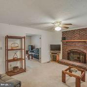 Family Room w Wood Fireplace - 11515 BEND BOW DR, FREDERICKSBURG