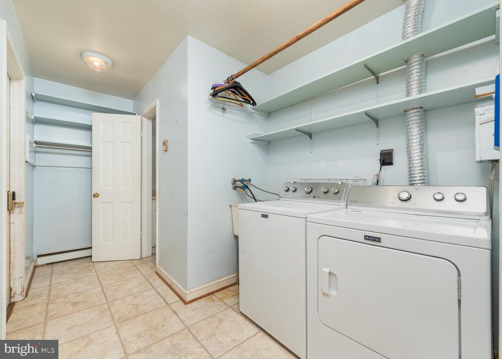 Laundry Room and Half Bath at Garage Entrance - 16201 DUSTIN CT, BURTONSVILLE