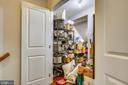 Built-out under-stair storage (past barn door) - 1418 N RHODES ST #B-112, ARLINGTON