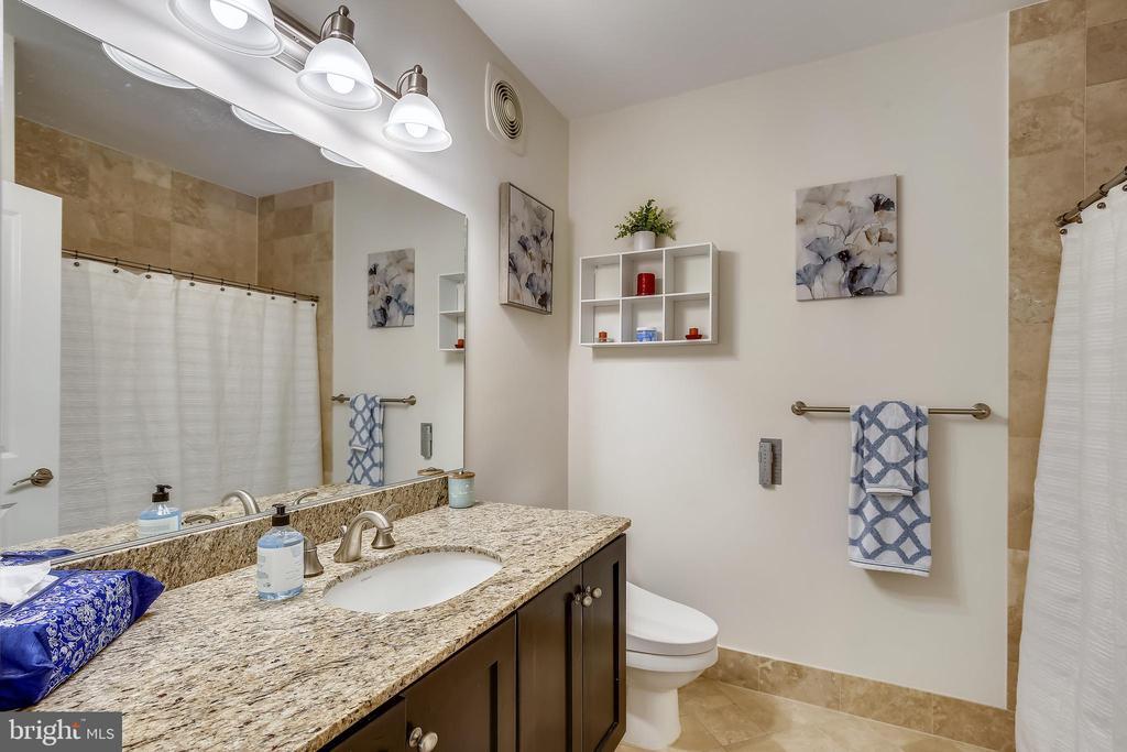 Upper-level guest bathroom with tiled shower - 1418 N RHODES ST #B-112, ARLINGTON