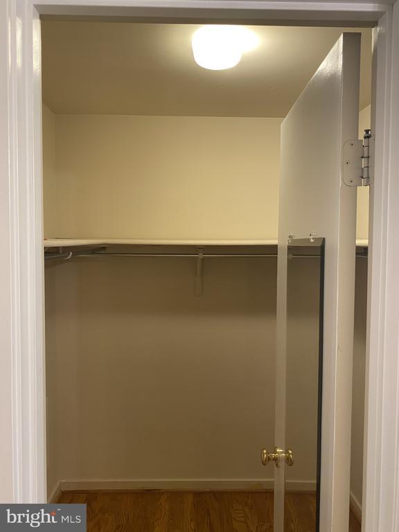 Primary bedroom walk in closet - 11605 CLUBHOUSE CT, RESTON