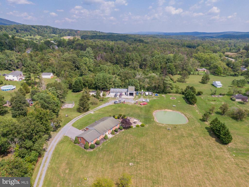 Drone view note space between home and garage/shop - 140 BOWMAN LN, WINCHESTER