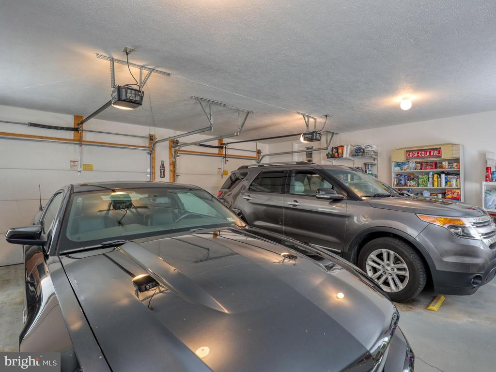 2 car attached garage with shelving/storage - 140 BOWMAN LN, WINCHESTER