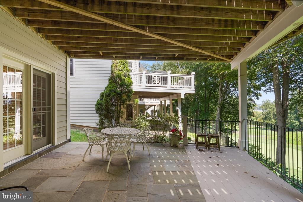 Lower Level: Shaded, stone w decking patio - 20260 ISLAND VIEW CT, STERLING