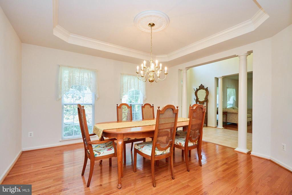 Dining room with tray ceiling off the foyer - 619 BRECKENRIDGE WAY, SHENANDOAH JUNCTION