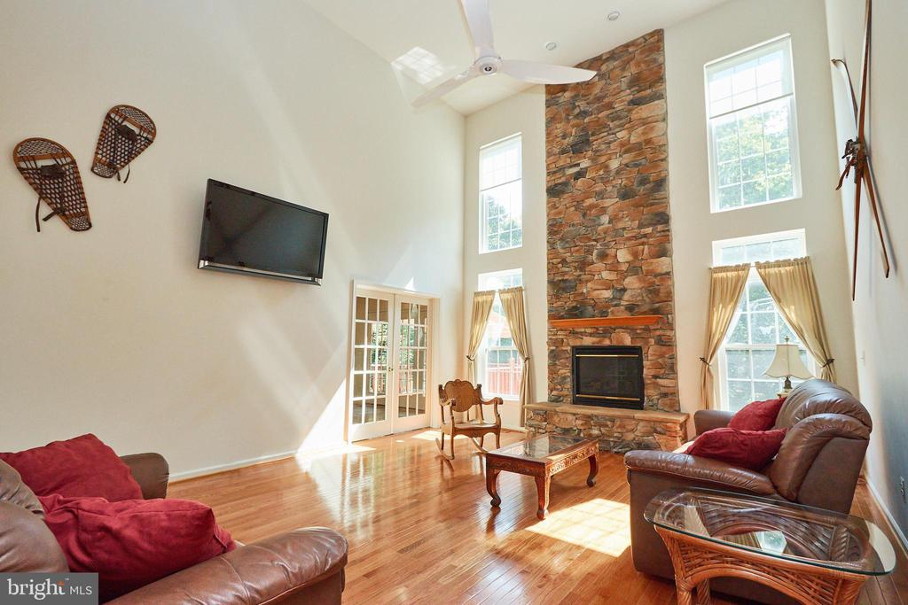Family room with French doors to 2nd sunroom - 619 BRECKENRIDGE WAY, SHENANDOAH JUNCTION
