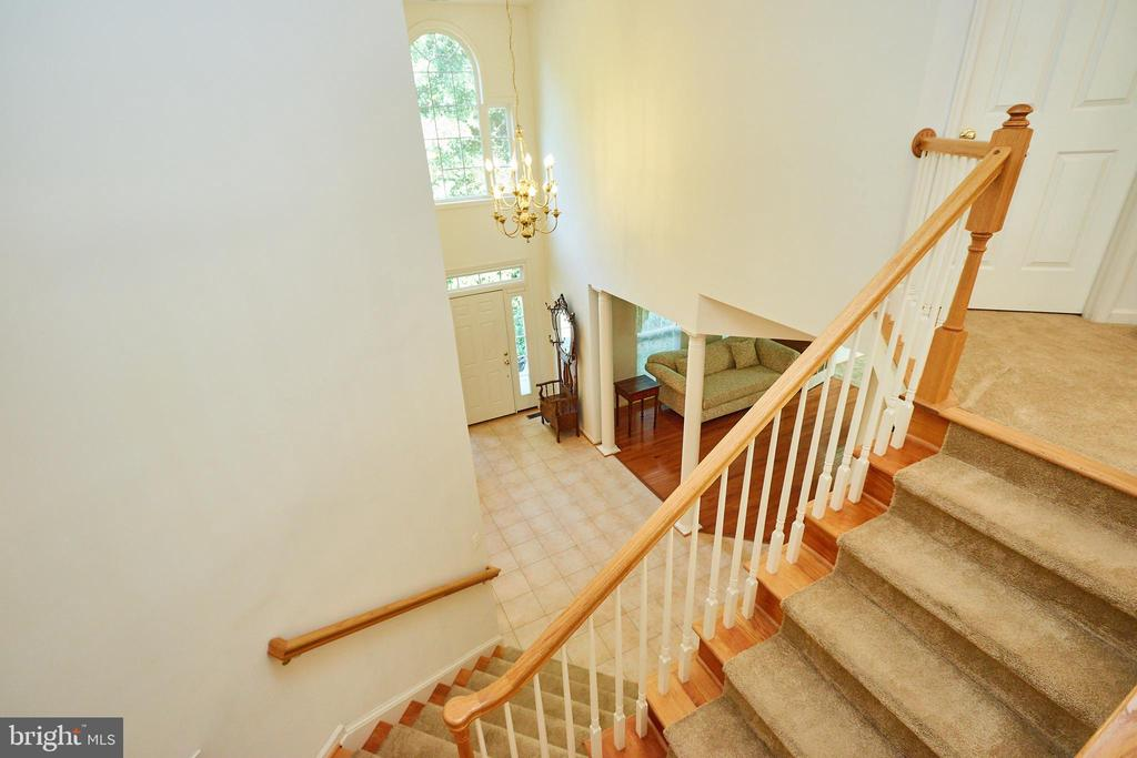 View to the foyer from the staircase - 619 BRECKENRIDGE WAY, SHENANDOAH JUNCTION