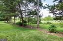 Nice group of trees between  you & the golf course - 25659 TREMAINE TER, CHANTILLY