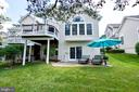 This home has both a patio and deck - 25659 TREMAINE TER, CHANTILLY