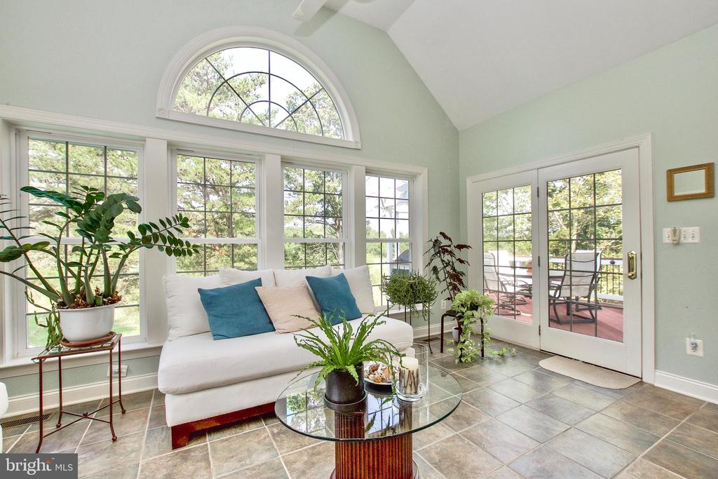 Door from sunroom leads out to deck with views - 25659 TREMAINE TER, CHANTILLY