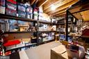 Shelving in unfinished area of basement conveys - 25659 TREMAINE TER, CHANTILLY