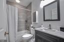 Full Bath in Basement decorated in tasteful gray - 25659 TREMAINE TER, CHANTILLY