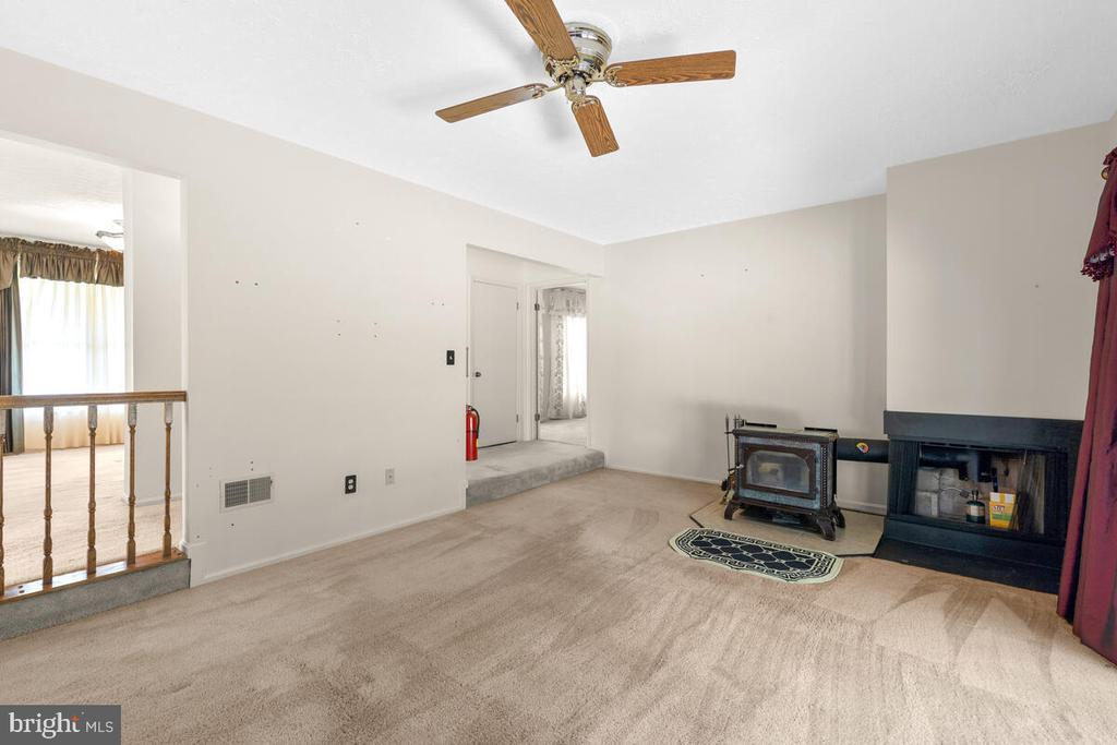 Family Room w/Wood Stove & ceiling fan - 3000 BEETHOVEN WAY, SILVER SPRING