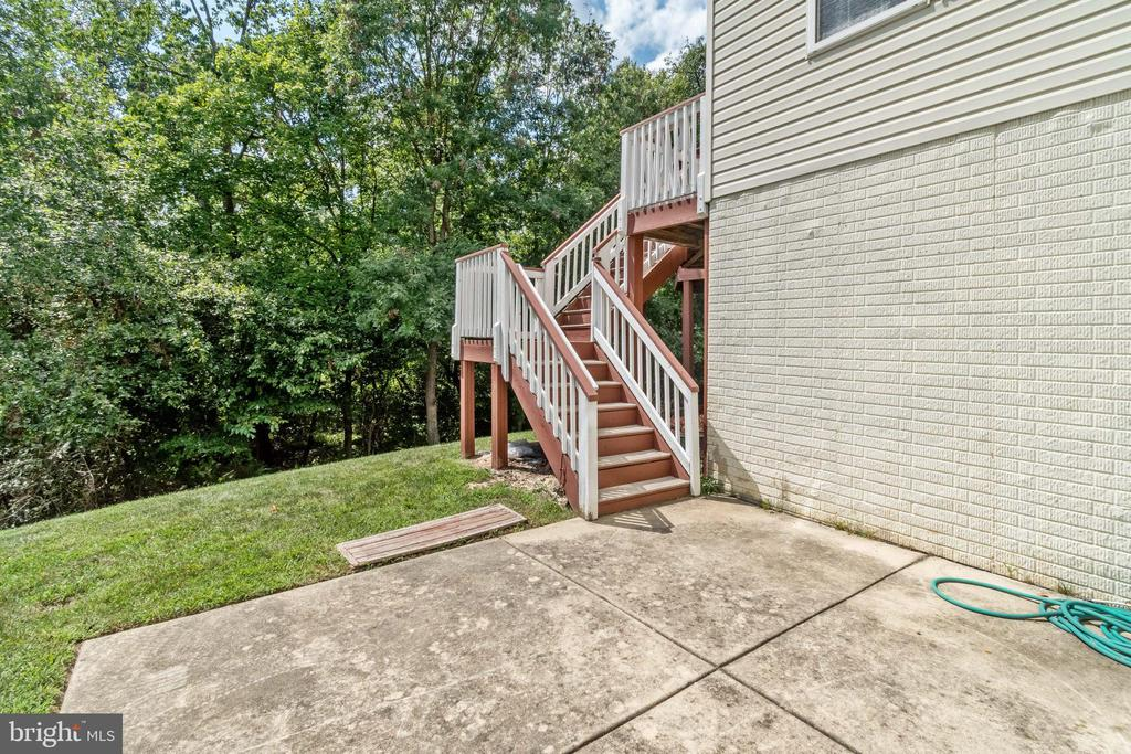 Stairs w/entry to and from Patio into Basement. - 7617 STRATFIELD LN, LAUREL