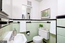 There is also a full bath on the main level - 6112 WOODMONT RD, ALEXANDRIA