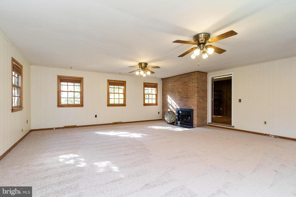 Cozy fireplace and access to the den/office area - 3208 SHOREVIEW RD, TRIANGLE
