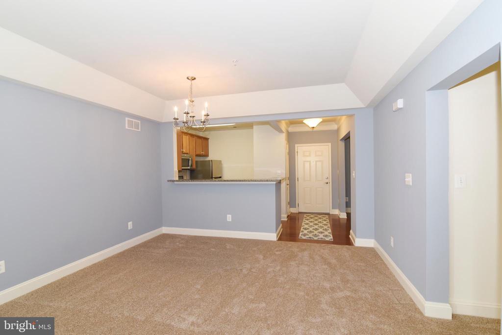 Living room open to kitchen - 9200 CHARLESTON DR #201, MANASSAS