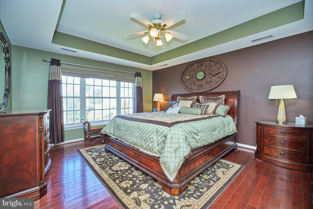 Primary Bedroom with Lighted Ceiling Fan - 9032 PADDINGTON CT, BRISTOW