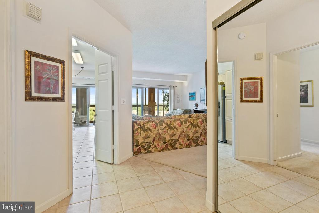 The foyer into your new home living room - 19375 CYPRESS RIDGE TER #711, LEESBURG