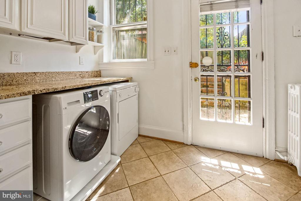 Front load washer and dryer under counter. - 321 F ST NE, WASHINGTON