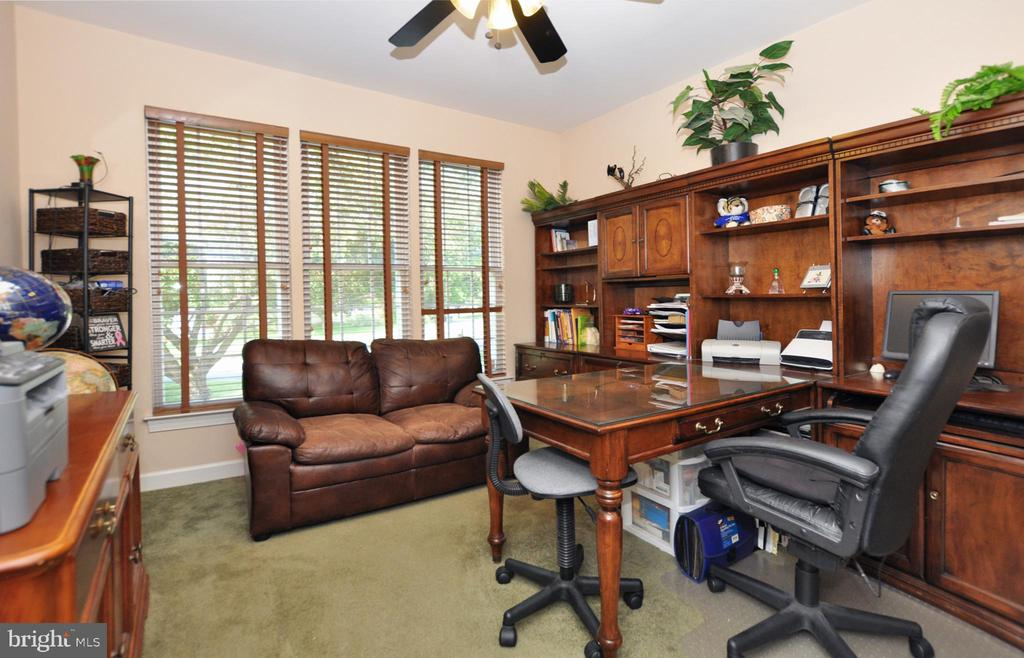 Main level office of foyer with ceiling fan. - 15305 LIONS DEN RD, BURTONSVILLE