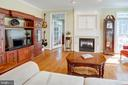 2-sided fireplace in Family Room sees into Office - 25891 MCKINZIE LN, CHANTILLY