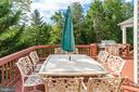 Deck is so big there's even more space for dining - 25891 MCKINZIE LN, CHANTILLY
