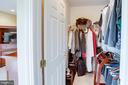 Two of two walk-in closets - 25891 MCKINZIE LN, CHANTILLY