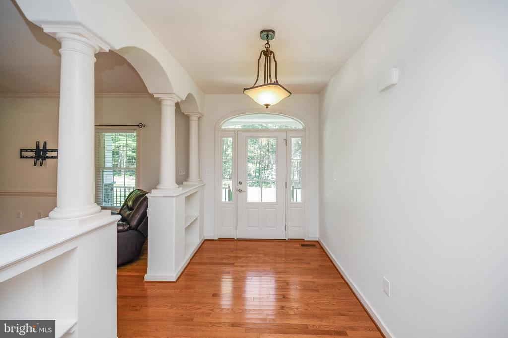 Foyer with built-ins and decorative front door - 12812 ORANGE PLANK RD, LOCUST GROVE