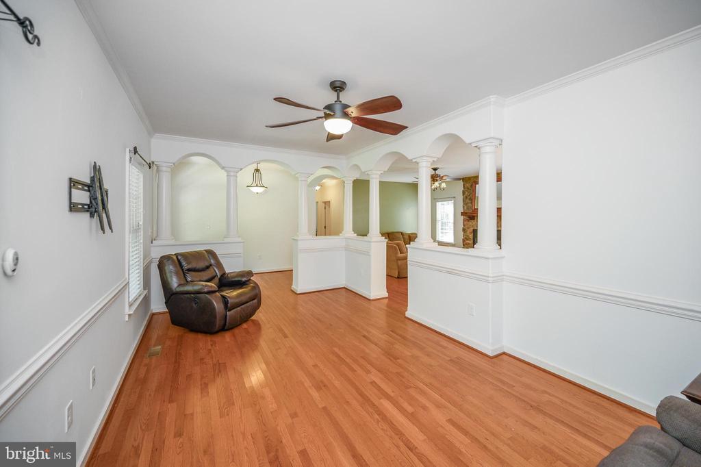 Love the columns that create the living room - 12812 ORANGE PLANK RD, LOCUST GROVE