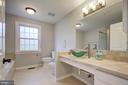 Updated bathroom with bidet and modern fixtures - 13832 TURNMORE RD, SILVER SPRING