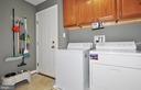 Main level laundry room w/ full size washer/dryer. - 15305 LIONS DEN RD, BURTONSVILLE
