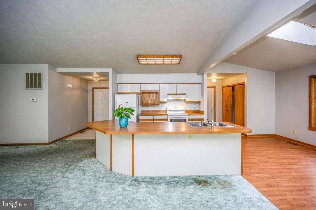 Kitchen Island, dining area & back hallway - 222 YORKTOWN BLVD, LOCUST GROVE