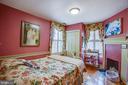 Sweet bedroom features a corner fireplace - 1501 CAROLINE ST, FREDERICKSBURG