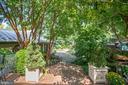 Brick patio leads down to addition & parking - 1501 CAROLINE ST, FREDERICKSBURG