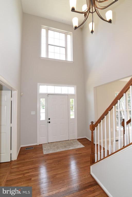Foyer with hardwood and updated lighting - 43847 AMITY PL, ASHBURN