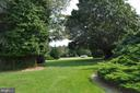 Exquisite plantings and verdant grass - 11690 FREDERICK RD, ELLICOTT CITY